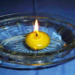 Floating beeswax candle