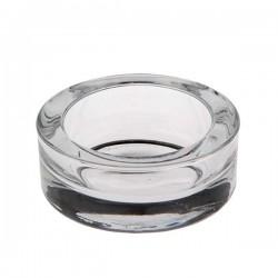 Bougeoir en verre transparent pour bougies.
