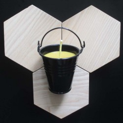 Beeswax candle in black bucket