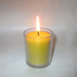 Beeswax candle in small glass pot