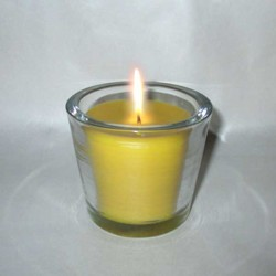 Beeswax candle in large glass pot